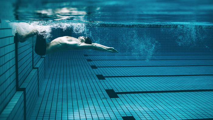 athlete developing run ready cardio through swimming to become running fit without running