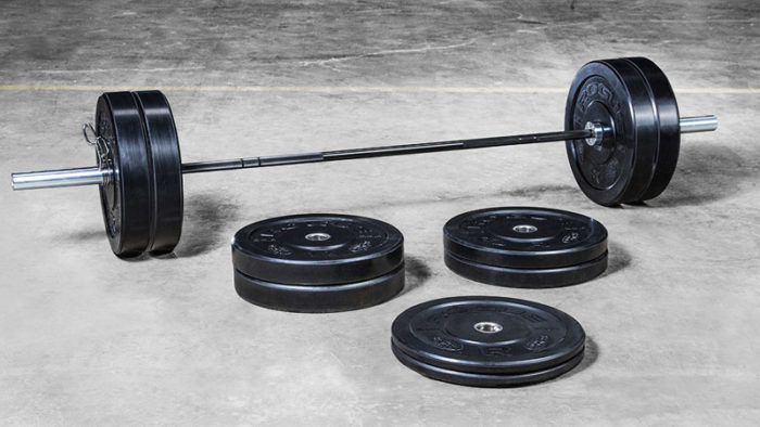 barbell and bumper plates being shown as essential piece of exercise equipment every home gym needs